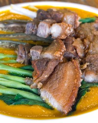 Closeup of Lechon Kawali na Kare Kare or Crispy Pork in Peanut Sauce. A Filipino fusion dish.