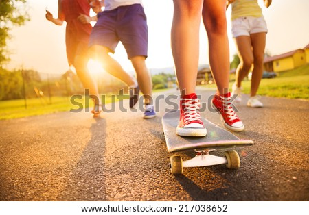 Closeup of legs and sneakers of young people on skateboard #217038652