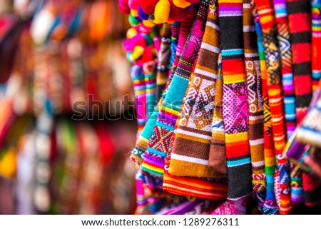 Closeup of light striped handbags with weaves on the souvenir store in Bolivia