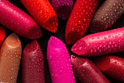 Closeup of lipsticks with water droplets