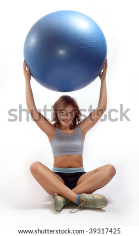 Closeup of little girl exercise with pilates ball
