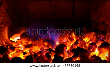 closeup of live coals in the hot stove