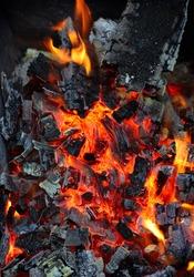 Closeup of live coals natural background
