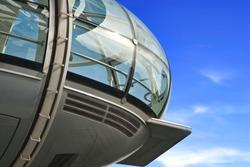 Closeup of London Eye capsule on blue sky