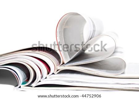 Closeup of magazine stack isolated on white