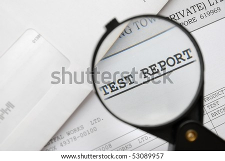 Closeup of magnifying glass on test report. For research and laboratory, science and technology, or medical concepts.