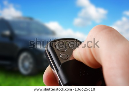 Closeup of male hand holding remote control car key