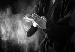 Closeup of male karate fighter hands. Black and white.
