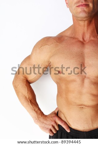 Closeup of males muscular chest and arm, isolated on white - stock photo
