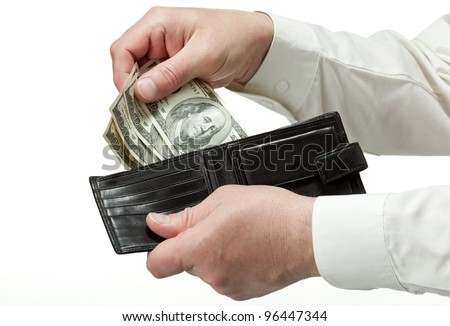 Closeup of man's hands holding leather wallet with dollars; isolated over white background