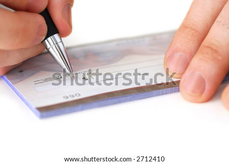 Closeup of man's hands writing a cheque