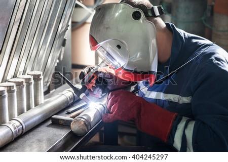 Closeup of man wearing mask welding in a workshop
