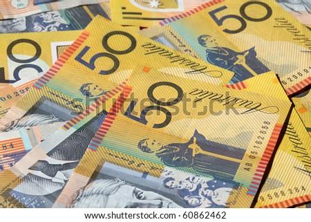 Closeup of many Australian 50 dollar notes. Shallow depth of field