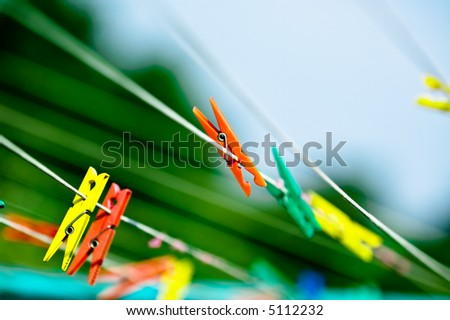Closeup of many clothespins hanging on the rope