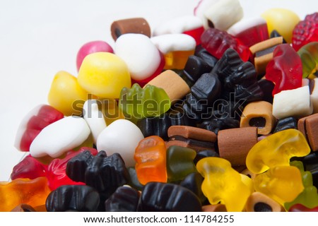 closeup of many colorful winegums isolated