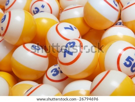Closeup of many yellow bingo balls background - stock photo