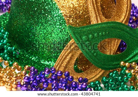 Closeup of Mardi Gras masks, hat, and beads.