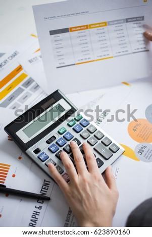 Closeup of Marketing Expert Hand Using Calculator - Shutterstock ID 623890160
