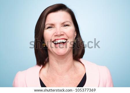 closeup of mature woman smiling - stock photo