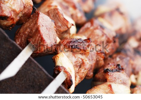 Closeup of meat cooking on a skewer