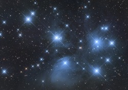 Closeup of Messier 45, called also Pleiades or Seven Sisters, its an open cluster in Taurus constellation and its reflection nebula, taken with my telescope.