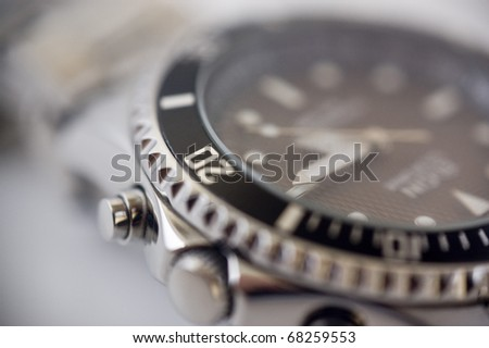 Closeup of metal wrist watch. - stock photo