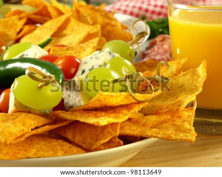 Closeup of mexican nachos and skewers with blue cheese,