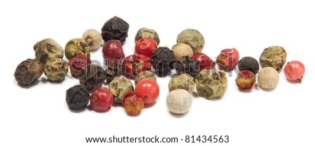 Closeup of mixed pepper isolated on white background.
