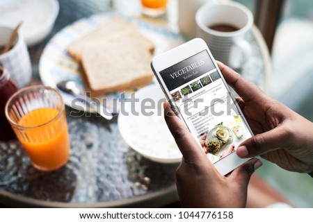 Closeup of mobile phone showing recipe on the screen