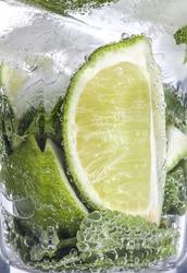 Closeup of mojito coctail in a transperant glass.