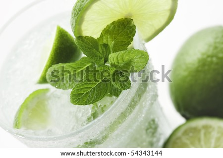 Closeup of Mojito with limes and mint on White background