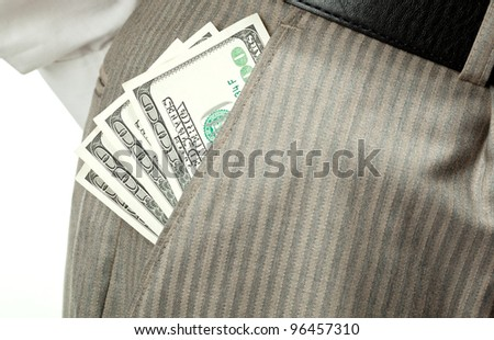 Closeup of money (dollar banknotes) in businessman's pocket