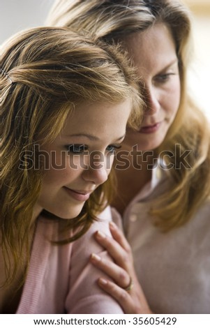 Closeup of mother with teenage daughter