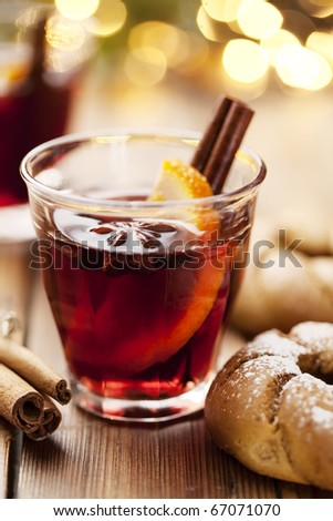 closeup of mulled wine, focus on the anise star, shallow dof
