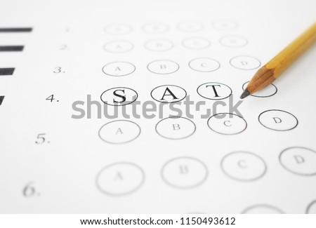 Closeup of multiple choice exam with SAT text and pencil Stok fotoğraf ©