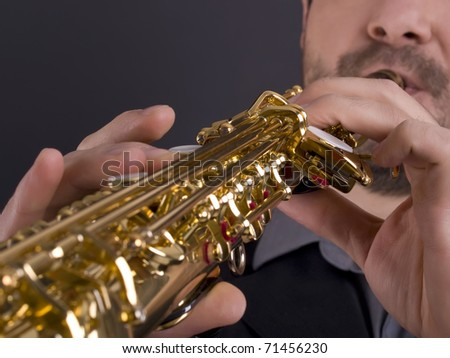 closeup of musician playing strait soprano saxophone