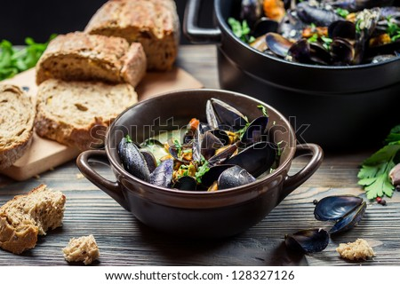 Closeup of mussels and fresh vegetables served at home