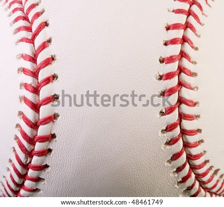 Closeup of new baseball with red stitches