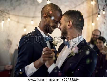 Closeup of Newlywed Gay Couple Dancing on Wedding Celebration