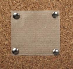 closeup of note paper  on cork board