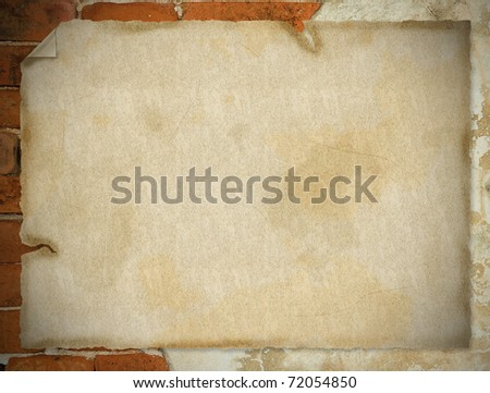 closeup of note paper on old weathered brick wall fragment