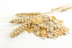 Closeup of oatmeal, corn flakes and wheat stems.Ripe cereal for breakfast