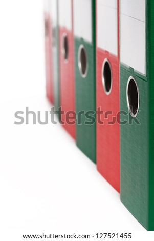 closeup of office ring binders on white background