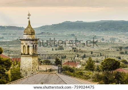 closeup of old church steeple landscape of the interior of zakynthos island and horizon with the ionian sea