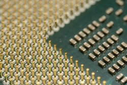 Closeup of old CPU Computer Processor with pins and green PCB
