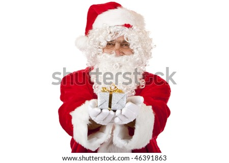 Closeup of old happy Santa Claus holding a Christmas present in his hands. Isolated on white.