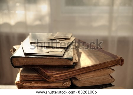 Closeup of old hundred years old books and photos.