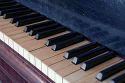 Closeup of old piano keyboard
