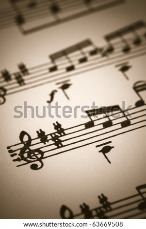 Closeup of old sheet music with selective focus in sepia