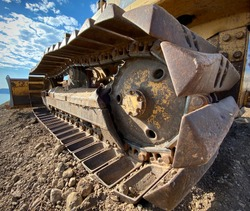 Closeup of old yellow bulldozer treads